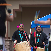 Donahue Dosedo, left, and Edward Lewis sing and play the drums for the Red Clay dance group Saturday at the Zuni Main Street Festival in Zuni Saturday.