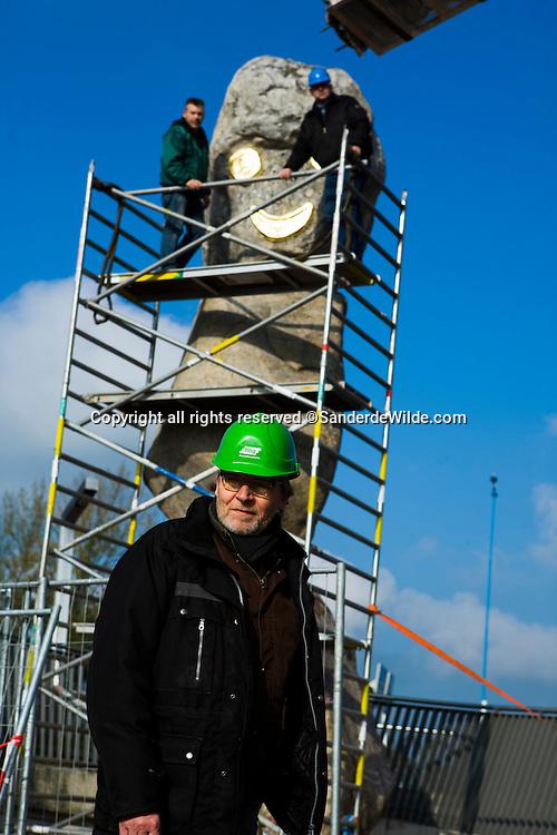 Portrait of famous Dutch sculptur Joost van den Toorn, in front of the potatoeman, Zoetermeer. These giant rocks were transported from Danmark, and are now his latest statue in Zoetermeer, near the Hague, called 'de Aardapplemannetjes' (The patatoemen). REPORTERS © Sander de Wilde