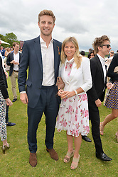 HARRY WENTWORTH-STANLEY and his mother the MARCHIONESS OF MILFORD HAVEN at the Cartier Queen's Cup Final polo held at Guards Polo Club, Smith's Lawn, Windsor Great Park, Egham, Surrey on 15th June 2014.