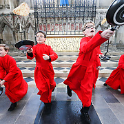 PIC BY GEOFF ROBINSON PHOTOGRAPHY 07976 880732.<br /> <br /> PIC SHOWS CHOIR BOYS FROM ELY CATHEDRAL ON MONDAY AFTERNOON MARCH 3RD  PRACTICING FOR THE ANNUAL PANCKE RACE WHICH TAKES PLACE IN THE CATHEDRAL TOMORROW ON SHROVE TUESDAY.(MARCH 4TH)<br /> <br />  Choristers have been practising today (Mon) for their traditional pancake race at Ely Cathedral in Cambridgeshire.<br /> <br /> The boys, aged 10 and 11, wore their red cassocks as they flipped pancakes to mark Shrove Tuesday.<br /> <br /> The annual event sees about 20 choristers race down the nave of the 12th Century Cathedral after Evensong. It is the third longest nave in the UK, measuring 75 metres.<br /> <br /> &quot;Choristers have taken part in a pancake race at the cathedral for as long as anyone can remember,&quot; said Lesley Ann Thompson, a spokeswoman for Ely Cathedral.<br /> <br /> &quot;It marks the start of Lent which is a period of austerity and it's something fun for the boys to do, they really enjoy it.&quot;<br /> <br /> SEE COPY CATCHLINE Choristers practice for pancake race