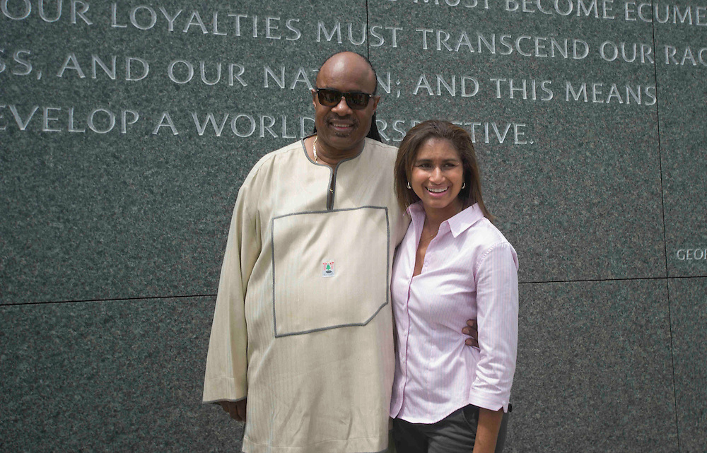 DISTRICT OF COLUMBIA (August 4, 2011) -- World famous American music icon Stevie Wonder poses for a photo after feeling his hand across the rough outer stone surface of the new Martin Luther King Jr., Memorial. Located across from the Jefferson Memorial and Tidal Basin, it commemorates the life and work of Dr. Martin Luther King, Jr., honoring his global contributions to world peace through non-violent social change. The new memorial looks to perform an official dedication on Sunday, August 28, 2011, which is the 48th anniversary of the March on Washington and Dr. King's historic I Have A Dream speech.  Photo by Johnny Bivera