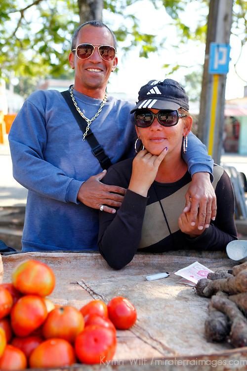 Central America, Cuba, Santa Clara. A Cuban couple sells fresh vegetables in Santa Clara.