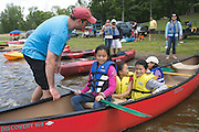John Kenney of Canadice Lake Outfitters helps young canoers at the Adirondack Mountain Club's Outdoor Expo at Mendon Ponds Park on Saturday, June 11, 2016.