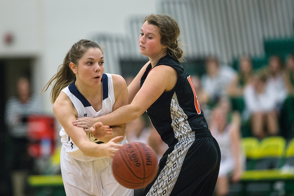 GABE GREEN/Press<br /> <br /> <br /> Timberlake senior Abbigale Seubert passes the ball around Post Falls player Madison King Tuesday night at the Youth Endowment for Activities 2013 varsity girls basketball jamboree hosted by Lakeland High.