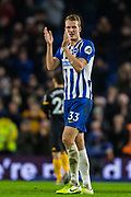 Dan Burn (Brighton) thanking the Brighton & Hove Albion FC supporters following the Premier League match between Brighton and Hove Albion and Wolverhampton Wanderers at the American Express Community Stadium, Brighton and Hove, England on 8 December 2019.