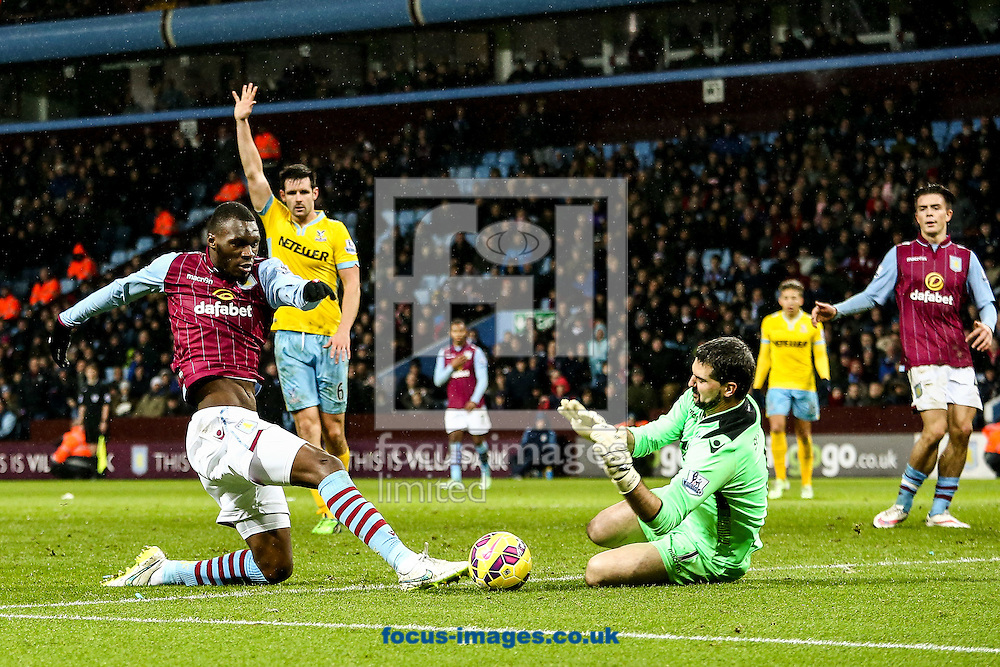 Christian Benteke of Aston Villa (left) is challenged by Julian Speroni of Crystal Palace (right) during the Barclays Premier League match at Villa Park, Birmingham<br /> Picture by Andy Kearns/Focus Images Ltd 0781 864 4264<br /> 01/01/2015