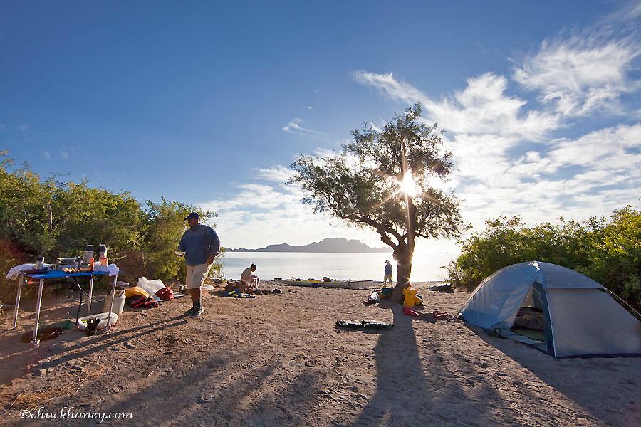 Guide prepare breakfast before sea kayaking trip in the Gulf of California near Loreto Mexico