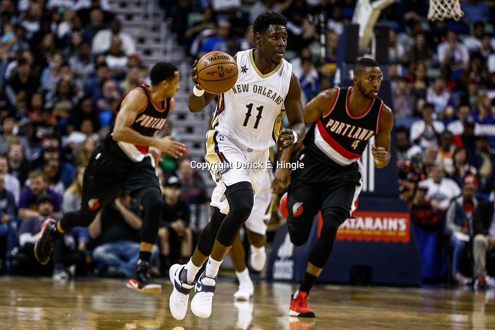 Mar 14, 2017; New Orleans, LA, USA; New Orleans Pelicans guard Jrue Holiday (11) drives down court against the Portland Trail Blazers during the first quarter of a game at the Smoothie King Center. Mandatory Credit: Derick E. Hingle-USA TODAY Sports