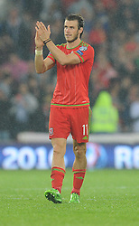 Gareth Bale of Wales (Real Madrid) claps the home fans at full time. - Photo mandatory by-line: Alex James/JMP - Mobile: 07966 386802 - 12/06/2015 - SPORT - Football - Cardiff - Cardiff City Stadium - Wales v Belgium - Euro 2016 qualifier