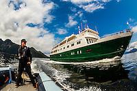"Skiff and Un-Cruise ship ""Wilderness Explorer"", coming out of Takatz Bay, Baranof Island, Inside Passage, southeast Alaska USA."