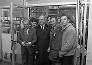 "Opening of New Ogra Fianna Fail office on O'Connell St,Dublin.1982.30.01.1982.01.30.1982.30th January 1982..Photograph of Mr Charles Haughey,.Leader of Fianna Fail cutting the ribbon to officially open th new ""Ogra"" office. He is accompanied by Mr George Colley T.D.,Mr Bertie Ahearn T.D.,Mr Tom Leonard (candidate) and Mr Paul Edgehill a member of Ogra Fianna Fail..."