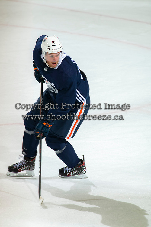KELOWNA, BC - SEPTEMBER 22:  Connor McDavid #97 of the Edmonton Oilers skates during practice at Prospera Place on September 22, 2019 in Kelowna, Canada. (Photo by Marissa Baecker/Shoot the Breeze)