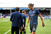 Portsmouth defender Christian Burgess (6) warming up before the EFL Sky Bet League 1 match between Peterborough United and Portsmouth at London Road, Peterborough, England on 15 September 2018.