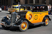 Vintage yellow taxi during Brisbane ANZAC day 2005 parade
