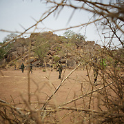 May 02, 2012 - Kauda, Nuba Mountains, South Kordofan, Sudan: A field commander of Sudan People?s Liberation Movement (SPLA-N) walks by in Jebel Kwo military base near Tess village in the rebel-held territory of the Nuba Mountains in South Kordofan. ..SPLA-North, a historical ally of SPLA, South Sudan's former rebel forces, has since last June being fighting the Sudanese Army Forces (SAF) over the right to autonomy and of the end of persecution of Nuba people by the regime of President Bashir. (Paulo Nunes dos Santos/Polaris)