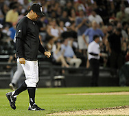 CHICAGO - JUNE 06:  Manager Ozzie Guillen #13 of the Chicago White Sox walks toward the pitchers mound during the game against the Seattle Mariners on June 6, 2011 at U.S. Cellular Field in Chicago, Illinois.  The White Sox defeated the Mariners 3-1.  (Photo by Ron Vesely)  Subject:  Ozzie Guillen