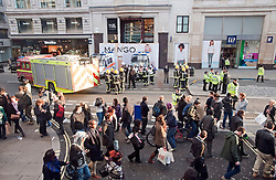 © London News Pictures. 07/03/2012. London, UK.  Shoppers walk past Police and Fire Brigade outside the Mango Store on Oxford Street, London where the hoarding collapsed injuring 4 people today (07/03/2012) . Photo credit : Ben Cawthra/LNP
