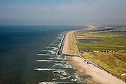 Nederland, Noord-Holland, Camperduin, 14-07-2008; Hondsbossche zeewering gezien naar het noorden, Petten op het middenplan; de dijk is aangelegd als zeewering nadat de oorsrponkelijke duien weggeslagen waren; door erosie kalven de duinen langs de kust steeds verder af, de dijk steekt daardoor steeds meer uit in zee; storm, Noordzee, Hondsbosse, duin, dijklichaam, zand suppletie, zeespiegelstijging, zwakke schakel, kust, duin, strand, kustonderhoud, gevaar, bescherming, kustverdediging. .luchtfoto (toeslag); aerial photo (additional fee required); .foto Siebe Swart / photo Siebe Swart
