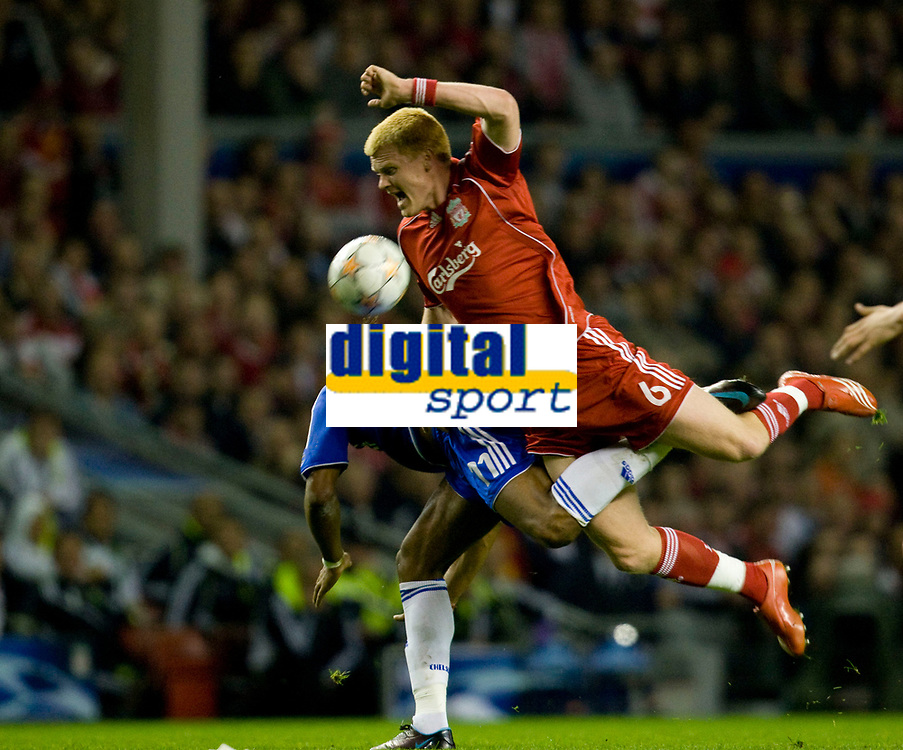 LIVERPOOL, ENGLAND - Tuesday, April 22, 2008: Liverpool's John Arne Riise is brought down by Chelsea's Didier Drogba during the UEFA Champions League Semi-Final 1st Leg match at Anfield. (Photo by David Rawcliffe/Propaganda)