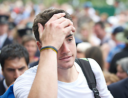 24.06.2010, Wimbledon, GBR, ATP World Tour, Grand Slam, Wimbledon, Men's singles, John Isner (USA) vs Nicolas Mahut (FRA), im Bild John Isner (USA) is escorted through the crowds after the historic longert game ever that lasted 11 hours and five minutes over three days with the final score 6-4 3-6 6-7 (7-9) 7-6 (7-3) 70-68 on day four. EXPA Pictures © 2010, PhotoCredit: EXPA/ Propaganda/ D. Rawcliffe / SPORTIDA PHOTO AGENCY