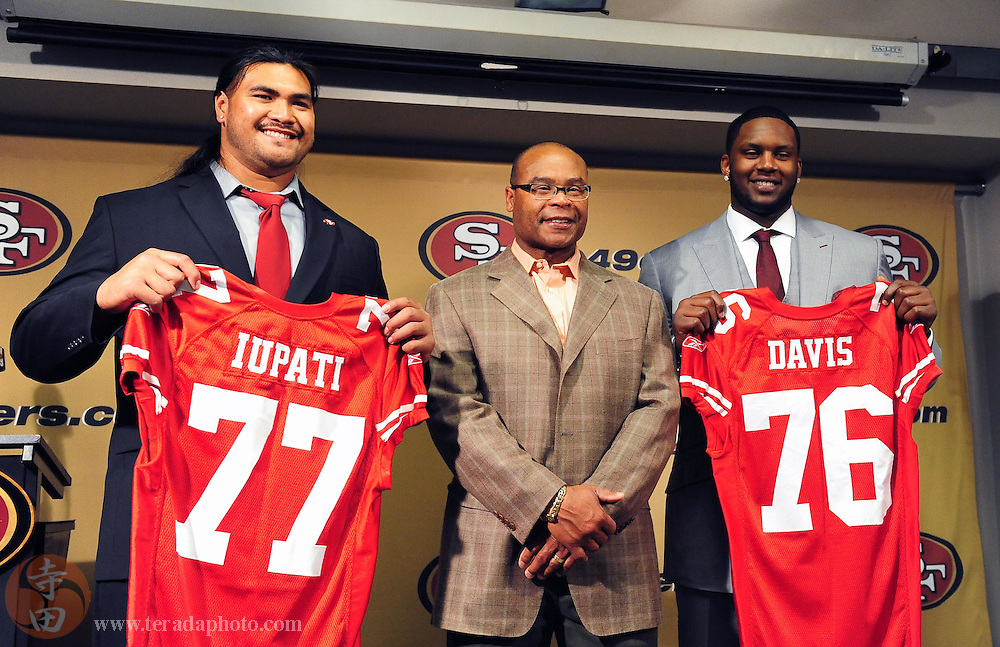 April 23, 2010; Santa Clara, CA, USA; San Francisco 49ers head coach Mike Singletary (center) poses for a picture with first round picks Mike Iupati (77) and Anthony Davis (76) during a press conference after the first round of the NFL Draft at the Marie P. DeBartolo Centre. Mandatory Credit: Kyle Terada-Terada Photo