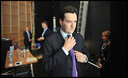 The Chancellor of the Exchequer George Osborne adjusts his tie backstage at the Conservative Party Conference in Manchester, moments before going on stage to deliver his speech, Monday October 3, 2011 Photo By Andrew Parsons/ i-Images