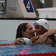 Camille Muffat, France, (left) is hugs team mate Coralie Balmy, after winning the Gold medal in the Women's 400m Freestyle Final at the Aquatic Centre at Olympic Park, Stratford during the London 2012 Olympic games. London, UK. 29th July 2012. Photo Tim Clayton