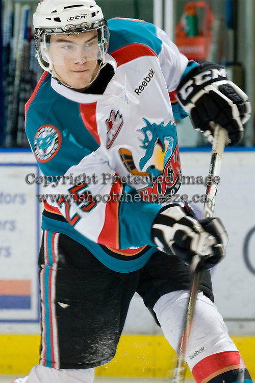 KELOWNA, CANADA, JANUARY 27: Colton Heffley #25 of the Kelowna Rockets takes a shot as the Seattle Thunderbirds visit the Kelowna Rockets on January 27, 2012 at Prospera Place in Kelowna, British Columbia, Canada (Photo by Marissa Baecker) *** Local Caption ***