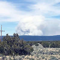 Smoke rises from a controlled burn in the Zuni Mountains as seen from Ramah Wednesday.