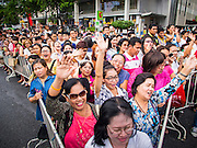 25 JULY 2014 - BANGKOK, THAILAND:   People cheer during a free concert by Ying Lee, a Thai Luk Thong style pop singer, at the party restore happiness to the people at Ratchaprasong Intersection. The party was organized and sponsored by the Tourism Authority of Thailand and was promoted as an effort to restart Thailand's tourism industry, which has seen a significant drop in foreign arrivals since political violence started in 2013. There has been no violence since the coup on May 22, 2014, but tourism has not completely rebounded.    PHOTO BY JACK KURTZ