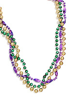 Mardi Gras beads on white background