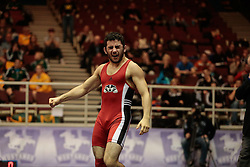 London, Ontario ---2013-03-02---    Zack Falcioni of  Brock celebrates after his win over Jason Wass of the University of Alberta, in the men's 57 KG bronze medal match at the 2012 CIS Wrestling Championships in London, Ontario, March 02, 2013. .GEOFF ROBINS/Mundo Sport Images