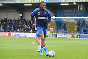 AFC Wimbledon defender Paul Kalambayi (30) warming up during the EFL Sky Bet League 1 match between AFC Wimbledon and Gillingham at the Cherry Red Records Stadium, Kingston, England on 23 November 2019.