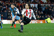Brentford midfielder Jota (23) takes a penalty, slips but scores (3-2) during the EFL Sky Bet Championship match between Brentford and Rotherham United at Griffin Park, London, England on 25 February 2017. Photo by Andy Walter.