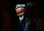 Old Uyghur men, Minfeng, Xinjiang Uyghur Autonomous Region, China.