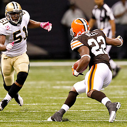 Oct 24, 2010; New Orleans, LA, USA; New Orleans Saints linebacker Jonathan Vilma (51) pursues Cleveland Browns running back Mike Bell during the second half at the Louisiana Superdome. The Browns defeated the Saints 30-17.  Mandatory Credit: Derick E. Hingle