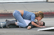 """May 14th 2010. Los Angeles, CA. ***EXCLUSIVE*** Adam Levine with his beautiful Russian Supermodel girlfriend Anne Vyalitsyna filming a Maroon 5 Music Video for their song; """"Misery"""". The sexy couple filmed various scenes of loving affection with passionate kissing followed by scenes of humorous violence and destruction. In this action packed Music Video shot on the streets of Downtown Los Angeles, Adam Levine and his band mates are fleeing from Anne Vyalitsyna who is humorously trying to kill them in various ways. Scenes include a missile gun attack and knife throwing from Anne, Adam being hit by a car while running away, Adam being close lined by Anne off a motorcycle that he is fleeing on,  Adam being kicked through a cafe window as well as being ejected from the window of a high rise building. The couple were constantly kissing, hugging and holding hands while on set. They both shared a big luxury trailer while not filming. Photo by Eric Ford/ On Location News. 818-613-3955. info@onlocationnews.com"""