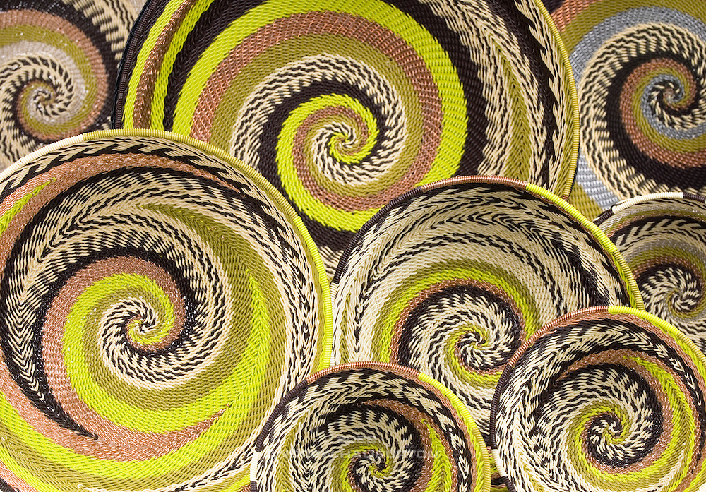 Woven wire baskets from South Africa. This style of hand-woven basket made from telephone wire is a contemporary development of the old craft of grass weaving. This is a traditional hand craft and artistic expression of the Zulu tribe from South Africa. In the new era of wireless communications this is a great example of recycling or reuse where a redundant material can be repurposed as the sole ingredient of beautiful folk art.
