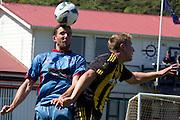 Danny Wilson (Hawkes Bay) and Sam Mason-Smith (Wellington). Team Wellington v Hawkes Bay United, ASB Premiership semi final at David Farrington Park, Wellington. 8 March 2014. Photo: Cameron McIntosh/www.photosport.co.nz