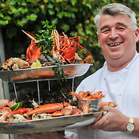 REPRO FREE<br /> Pictured at the 4-course Fruits de Mer Luncheon during the 39th Kinsale Gourmet Festival is chef Martin Shanahan with the seafood platter that's placed on every table.<br /> Picture. John Allen<br /> <br /> KINSALE GOURMET FESTIVAL PRESENTS:<br /> A WEEKEND OF FINE FOOD AND WINE IN A FUN ATMOSPHERE<br /> The 39th Kinsale Gourmet Festival takes place from 9-11 October 2015, promising a weekend of fine food and wine in a fun atmosphere.  The Festival is hosted by Kinsale's eleven Good Food Circle restaurants, which go to great lengths to display the talent of their chefs, and their beautifully presented food. The emphasis is on locally-sourced ingredients from sea and land, accompanied by carefully selected wines. The United States Ambassador to Ireland, Kevin O'Malley, will be a guest in Kinsale for Friday and Saturday's Good Food Circle events. Kinsale Gourmet Festival has many regular visitors from overseas, including the United States and Canada. There are still some tickets left for Friday evening's opening event, a champagne reception, courtesy of Laurent Perrier, and a 5-course 'Taste of West Cork' dinner in a Good Food Circle restaurant of your choice.  Meanwhile, everyone is welcome to the 'Cork Heat' of the All-Ireland Chowder Cook-Off on Friday afternoon, sponsored by Clóna.<br /> 	Acton's Hotel is the venue for the Cork Heat of the All-Ireland Chowder-Cook off  at 3pm on Friday 9 October.  The €5 admission fee includes the chance to win a €100 gift voucher from the Kinsale Good Food Circle, as well as a tasting sample of each chef's chowder, and free samples from specialised local brewers of craft beers and cider makers.  Some outstanding chefs are expected to compete, including the very popular winner of last year's Cork Heat, The Cornstore.  An entertaining afternoon is guaranteed, as the chefs display their skills with seafood, sharing their secret ingredients, as they compete to produce the tastiest chowder.  The winning chef will represent Cork at the 6th All-Irela