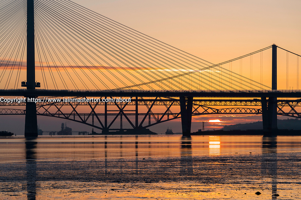 Sunrise view of the three major bridges crossing the Firth of Forth at South Queensferry; Queensferry Crossing, North Road Bridge and the Forth Bridge ( rail) , Scotland, United Kingdom.