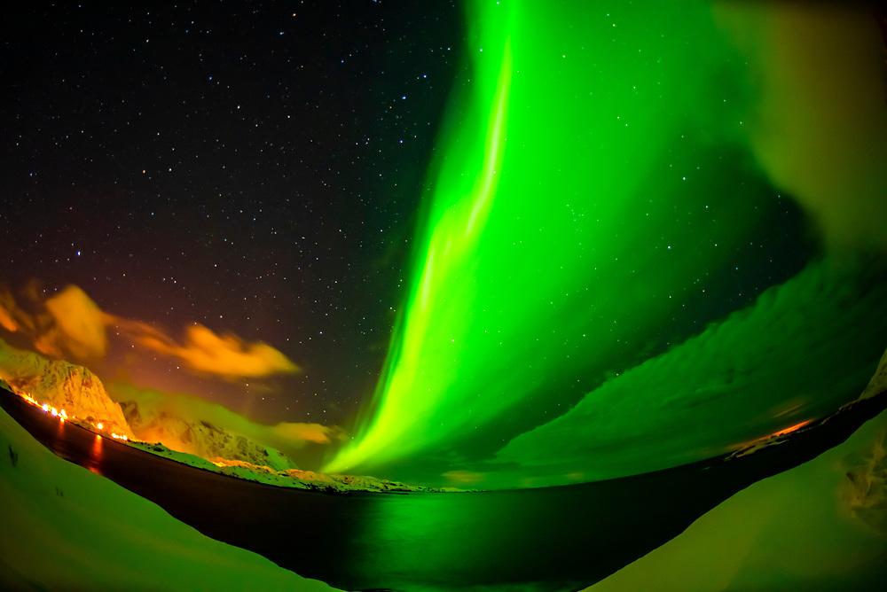 Dancing Northern Lights (Aurora Borealis) seen from along the E10 near Reine, Moskenoesoya Island, Lofoten Islands, Arctic, Northern Norway.