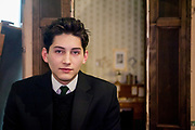 Franz Kafka lookalike Marek Lentvorsky (21) pictured in front of the original and faithful replica of Gregor Samsa's room at the Goethe Institute in Prague