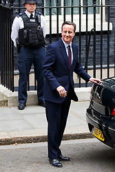 © Licensed to London News Pictures. 08/05/2015. LONDON, UK. Prime minister and Conservatives leader David Cameron leaving Downing Street to visit the Queen for a formal permission to form a Conservative majority government on Friday, 8 May 2015 following the 2015 General Election. Photo credit : Tolga Akmen/LNP