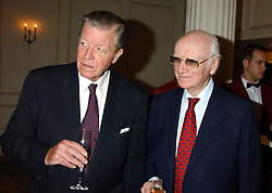 Left to right, MICHAEL OSWALD and SIR PETER O'SULLEVAN at The Sir Peter O'Sullevan Charitable Trust Lunch at The Savoy, London on 23rd November 2005.<br />