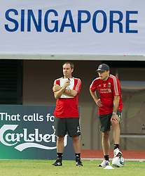 SINGAPORE, SINGAPORE - Sunday, July 17, 2011: Liverpool's assistant manager Steve Clarke and Director of Football Strategy Damien Comolli during an exhibition training session at the Bishan Stadium in Singapore on day seven of the club's preseason Asia Tour. (Photo by David Rawcliffe/Propaganda)