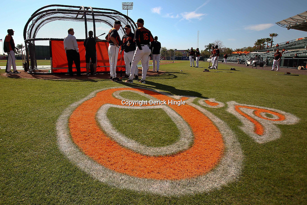 March 14, 2011; Sarasota, FL, USA; Baltimore Orioles manager Buck Showalter talks with batting coach Jim Presley and instructor Terry Crowley during batting practice  before a spring training exhibition game at Ed Smith Stadium.  Mandatory Credit: Derick E. Hingle-US PRESSWIRE