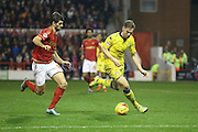 Nottingham Forest forward, on loan from Benfica, Nelson Oliveira  and Leeds United defender Charlie Taylor  battle for the ball during the Sky Bet Championship match between Nottingham Forest and Leeds United at the City Ground, Nottingham, England on 27 December 2015. Photo by Simon Davies.