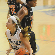 Hoggard's Julia Buehler drives around New Hanover's Tonasia Toomer Friday December 12, 2014 at Hoggard High School in Wilmington, N.C. (Jason A. Frizzelle)