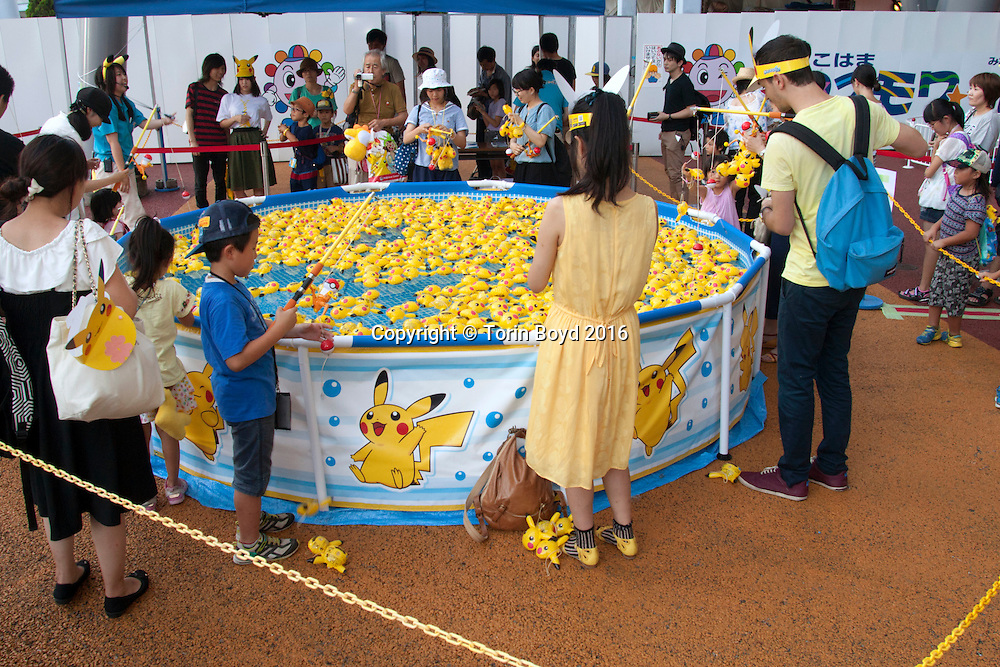 August 7, 2016, Yokohama, Japan: This is a free Pikachu fishing pond at Yokohama Cosmoworld, a theme park with rides, games, a ferris wheel and roller coaster rides. This was part of Pikachu Outbreak!, a weeklong extravaganza dedicated to Pikachu, the lovable Pokemon character held in Yokohama from August 7 -14, 2016. This annual summer event started in 2014 involves hundreds of Pikachu mascots and huge inflatables making appearances at venues throughout the city's waterfront district known as Minato Mirai. Events include a parade of dancing Pikachu mascots, a large gathering of Pikachu splashing themselves and fans, a hula dance event, a Pikachu fishing pool, stage performances, Pikachu merchandise for sale and Pikachu photo studios. (Torin Boyd/Polaris).